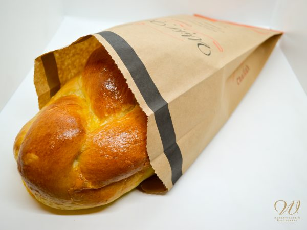 Wild Wheat Challah bread in a paper bag