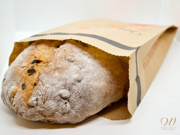 Wild Wheat Hazelnut Currant bread in a paper bag