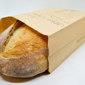 Wild Wheat kalamata olive bread in a paper bag